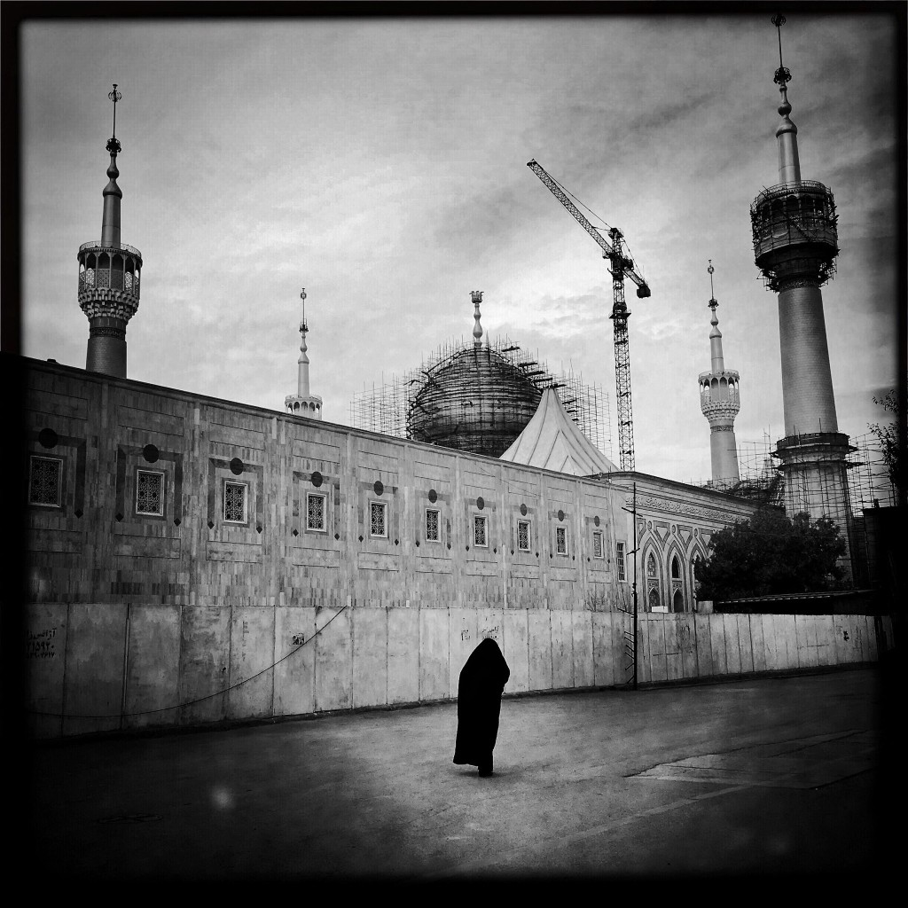 Lone woman walking outside the Imam Khomeini Mausoleum