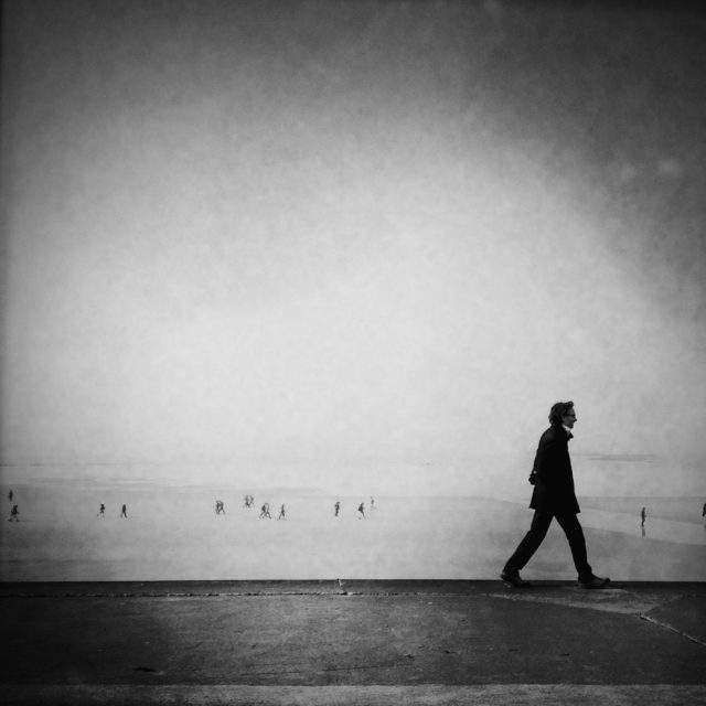 A man on the way, Saint-Malo, Brittany. By the sea, streetphotography is a topic not broached enough. Life by the sea is not only landscapes, there are also people who are as interesting as in the big cities like New York or Paris.
